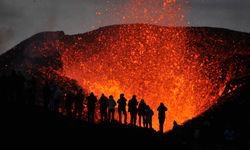 People watching a volcanic eruption
