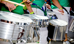Drummers in green