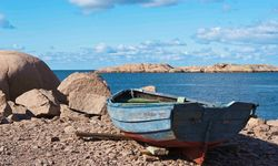 A Rowing Boat on Pebbled Beach in Lysekil