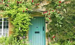 A blue front door of a Cotswold cottage