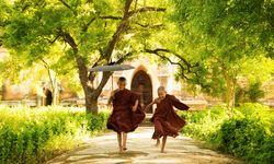 Monks running in Myanmar