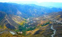 Winding Roads through Mountains