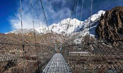 Bridge with snowy Himalaya backdrop