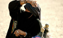 Bedouin woman in desert heat