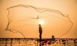 Myanmar fisherman and net