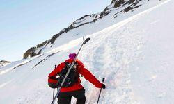 A Skier Climbing a Mountain