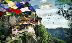 Tiger's Nest Monastery with surrounding scenery and prayer flags
