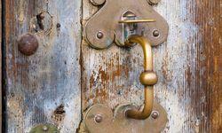 A Wooden Door with Metal Handle