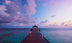 Sunset over Maldives pier