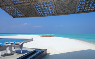 Terrace on the beach at Four Seasons Landaa Giraavaru