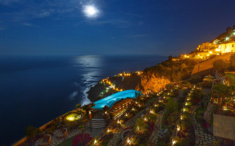 The exterior with pool at night