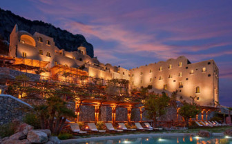 The swimming pool at night at Monastero Santa Rosa, luxury hotel in Italy