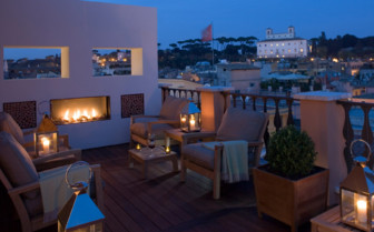 Private terrace with fireplace at Portrait Roma hotel