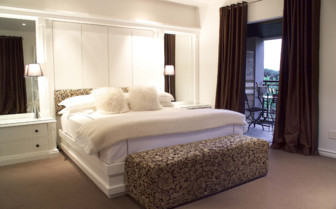 Luxury bedroom at Kensington Place hotel