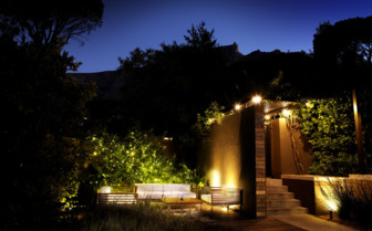 The hotel garden at night at Kensington Place hotel
