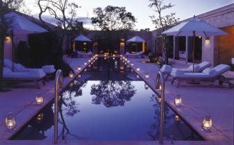 The swimming pool at night at Royal Malewane