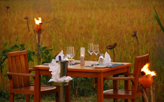 Outdoor dining at Vil Uyana, luxury hotel in Sri Lanka