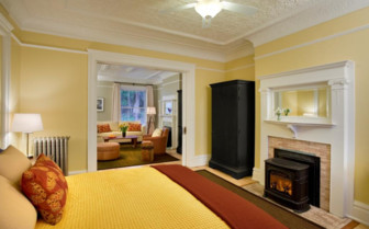 The bedroom with fireplace at Cavallo Point, luxury hotel in the Big Sur
