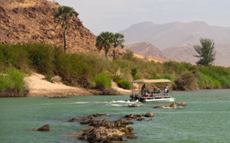 Boat tour on the river at Okahiringo River Camp