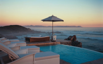 Pool with ocean view at sunset