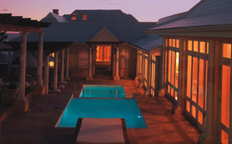 The mainpool at night at Birkenhead House, luxury hotel in South Africa