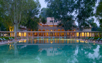 The swimming pool at Amanbagh, luxury hotel in India
