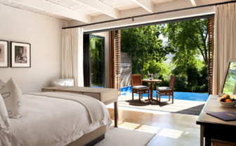 Deluxe bedroom and pool view