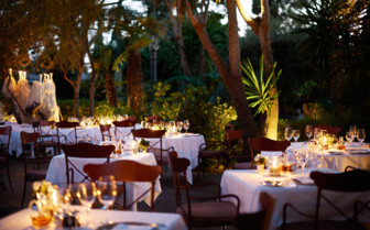 Outdoor dining area at Marbella Club, luxury hotel in Spain