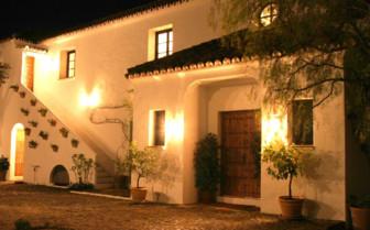 The exterior at night at La Almuna hotel