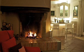 The interior fire place in the dining area of the hotel