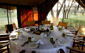 Dinner table at Serian Serengeti, luxury camp in Tanzania