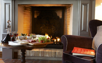 Suite lounge at the fireplace at Hawksmoor hotel