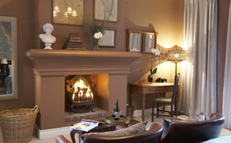 The suites living room area with fireplace at the hotel