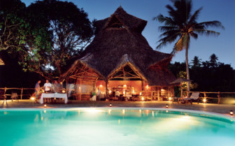 Picture of the swimming pool at night at Fundu Lagoon