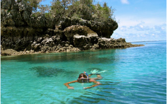Picture of snorkelling in the sea in front of Chole MIjini, luxury hotel in Africa