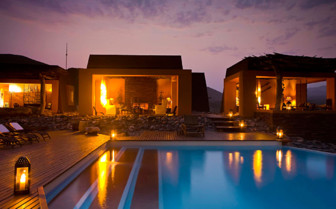 The Lodge with pool area at night