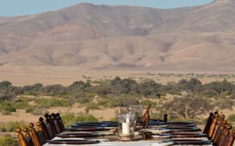 Outdoor dining at Okahirongo Elephant Lodge, luxury lodge in Namibia