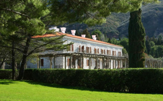 The hotel exterior and gardens at Villa Milocer