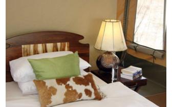 Bed detail at Manyara Ranch, luxury ranch in Tanzania