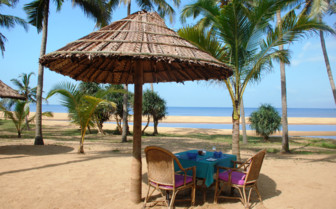 Beach dining at Neeleshwar Hermitage, luxury hotel in India