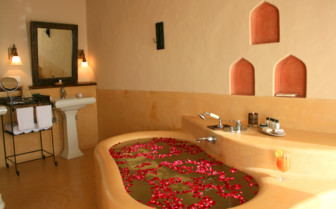 Bathroom with tub at Mihir Garh, luxury hotel in India