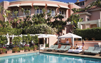 The swimming pool at Beverly Hills Hotel, luxury hotel in Los Angeles