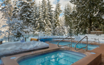 The outdoor pool and hot tub at Nita Lake Lodge, luxury hotel in British Columbia, Canada