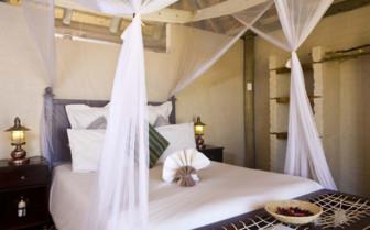 Bedroom at Desert Homestead, luxury hotel in Namibia