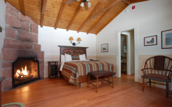 Bedroom with fireplace at Zion Lodge