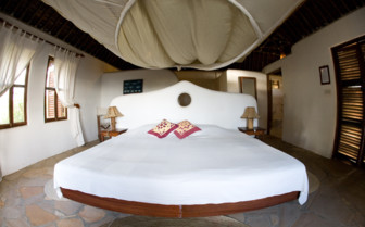 Double bed at Tides Lodge, luxury hotel in Tanzania