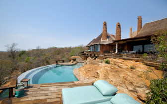 The swimming pool with sun loungers at the reserve