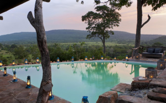 The pool at night at Beho Beho Camp, luxury hotel in Tanzania