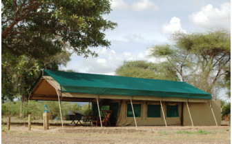 Tent exterior at Mdonya Old River Camps, luxury camp in Tanzania
