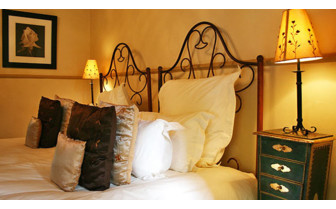 Bedroom detail at Hartford House, luxury hotel in South Africa